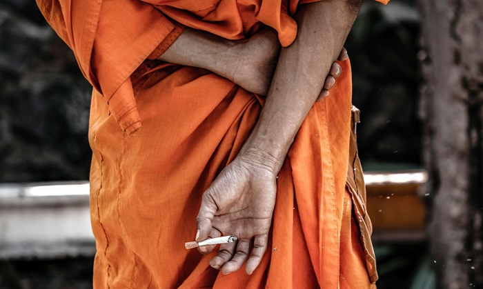 Thai monk smoking